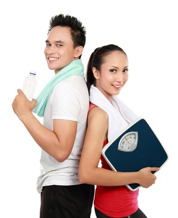 indonesian: Portrait of sporty healthy young woman and man isolated on white background