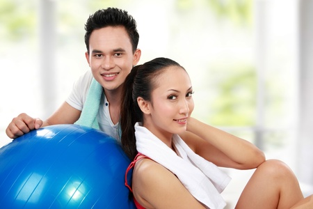 portrait of Fitness  Smiling young man and woman after workout in the gym photo