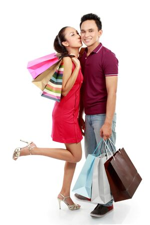 full body portrait of Romantic young couple shopping isolated on white background Stock Photo - 13231372