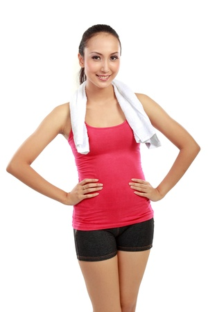 Retrato de Fitness mujer mirando a la cámara sobre fondo blanco