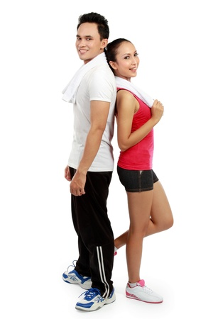 muscularity: portrait of Fitness  Smiling young man and woman  Isolated over white background Stock Photo