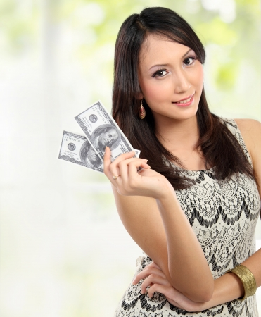 pay bills: woman showing  100 us dollar money