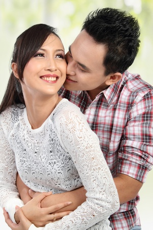 Happy young couple embracing, having fun together Stock Photo