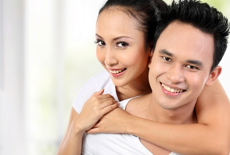 close up portrait of asian happy couple smile photo