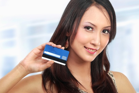 attractive asian woman showing  credit card for shopping photo