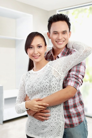 Portrait of happy Young couple at their new house photo