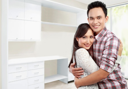 adorable home: Portrait of happy Young couple at their new house