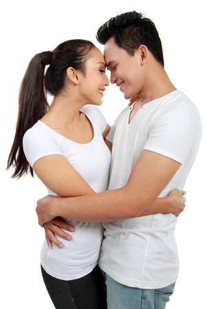 Portrait of a romantic happy couple isolated over white background photo