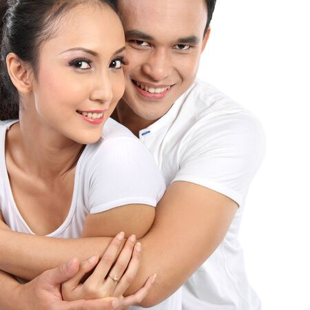 close up portrait of asian happy couple smiling looking at camera isolated on white photo
