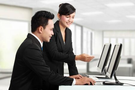 woman and man office worker working in the office Stock Photo - 13329225
