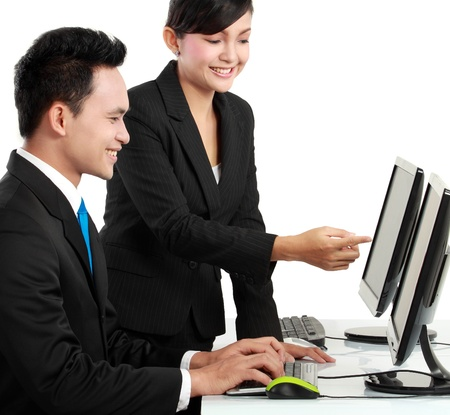 discuss: woman and man office worker working in the office