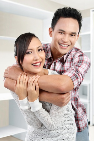 Portrait of romantic happy couple in a new house photo