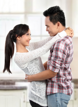 happy asian couple: Portrait of romantic happy couple smiling looking each other