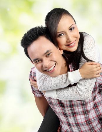 Portrait of romantic happy couple in green nature photo