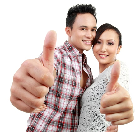 happy asian people: close up portrait of young happy couple showing thumb up Stock Photo