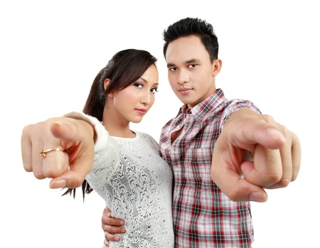 close up portrait of young couple pointing at camera photo