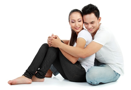 young asian girl: Portrait of beautiful young happy couple sitting on the floor