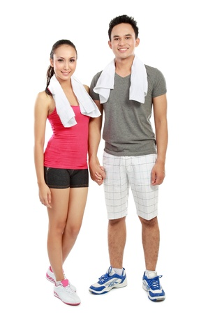 Portrait of sporty healthy young woman and man isolated on white background photo