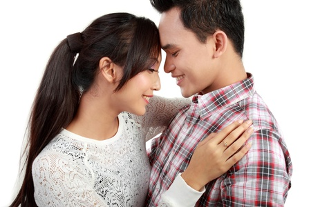 asian man smiling: close up portrait of asian happy couple smiling looking each other Stock Photo