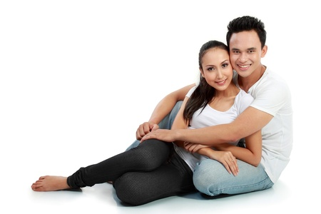 portrait of asian happy couple smiling on white background photo