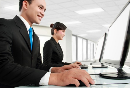 woman and man office worker working in the office Stock Photo - 13516293