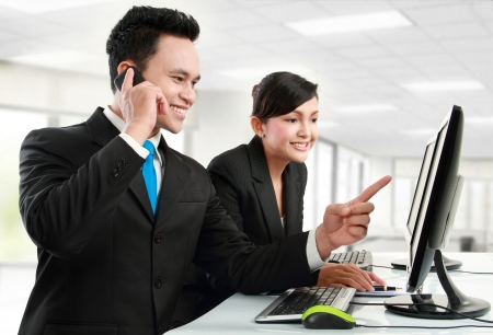 telephone together: woman and man office worker meeting in the office
