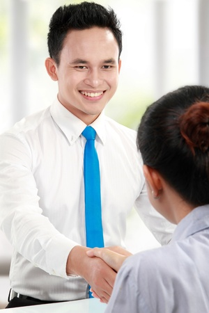 deal in: business man make a deal with business woman in his office