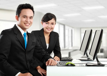 business results: happy woman and man office worker working in the office