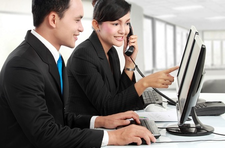 landline phone: woman and man office worker meeting in the office