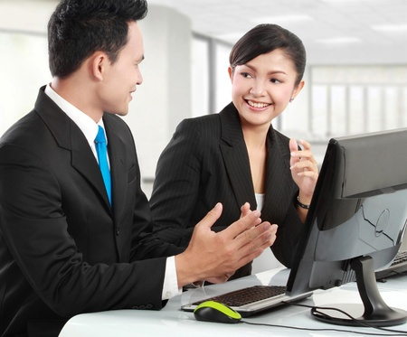 woman and man office worker meeting in the office photo