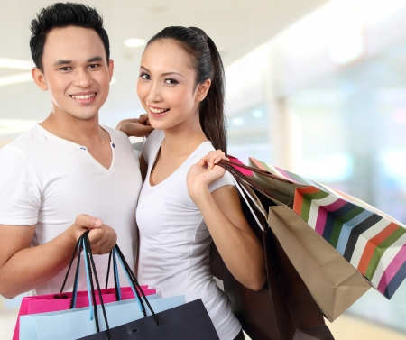young attractive happy couple at shopping mall photo