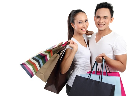 young attractive happy couple carrying shopping bag photo