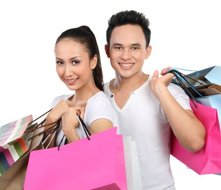 smiling couple with shopping bag isolated over white background Stock Photo - 13528205