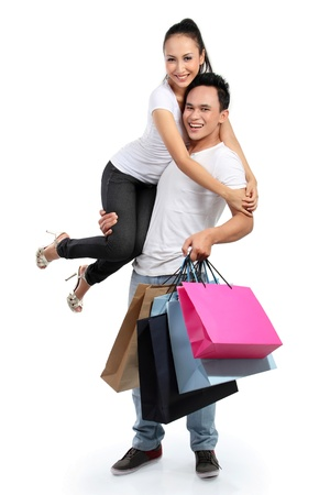 full lenght portrait of happy couple with shopping bag on white background photo