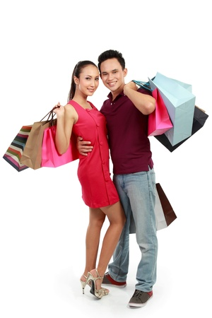 portrait of happy couple with shopping bags on white background photo