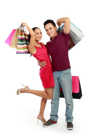 young attractive happy couple having fun with shopping bags photo