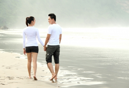 loving couple spending quality time with each other on beach photo