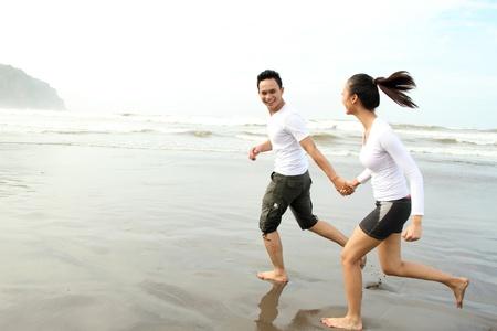 Romantic couple having fun on the beach photo