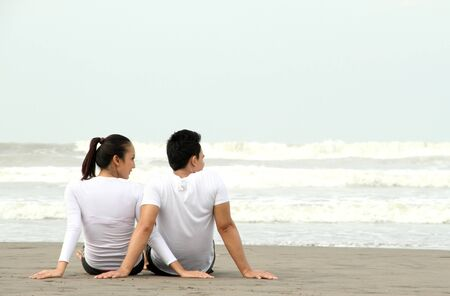 loving couple relaxing and spending quality time with each other on beach photo