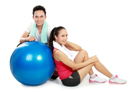 full body portrait of sporty couple with pilates ball isolated on white background photo