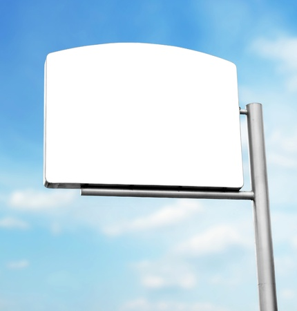 outdoor advertising: blank white sign board in blue sky background Stock Photo