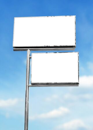 advertising board: blank white sign board in blue sky background Stock Photo