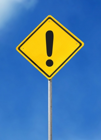 warning signs: exclamation yellow road sign on sky background Stock Photo