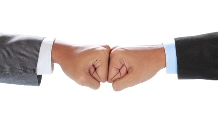 The businessman's hand hit each other isolated on white background Stock Photo - 14065039