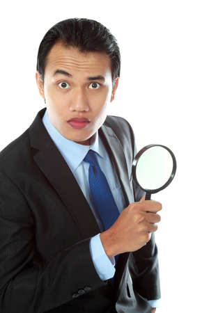 solver: Portrait of asian business consultant holding a magnifier glass