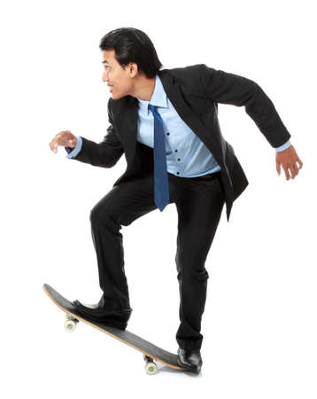 asian executive on skateboard isolated on white background photo