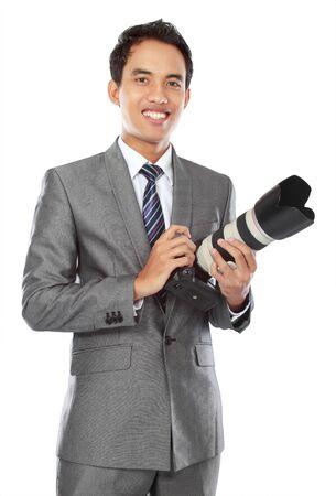 portrait of asian professional photographer ready to take some photo Stock Photo - 14323458