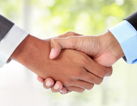 negotiation business: gesture of businessmans hand shaking