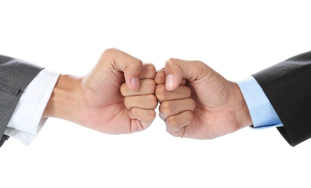 The businessmans hand hit each other isolated on white background Stock Photo