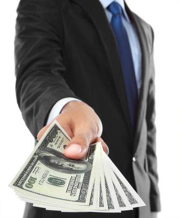 mano con dinero: cerca de dinero de negocios que ofrece la mano aisladas sobre fondo blanco Foto de archivo